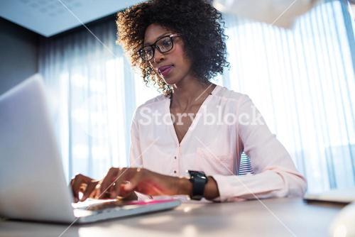Businesswoman typing on her computer