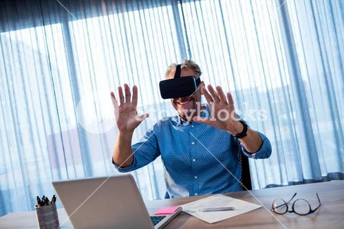 Businessman using an oculus