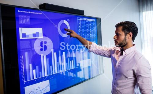 Businessman analyzing data with a touch screen
