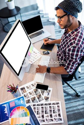 Photographer working at computer desk