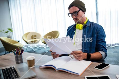 Hipster looking at a document