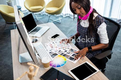 Business woman looking at pictures