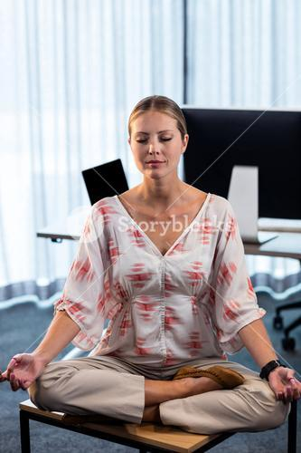 Portrait of businesswoman doing yoga