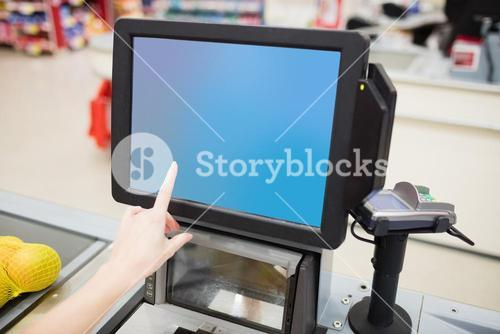 Focus on a cashiers screen
