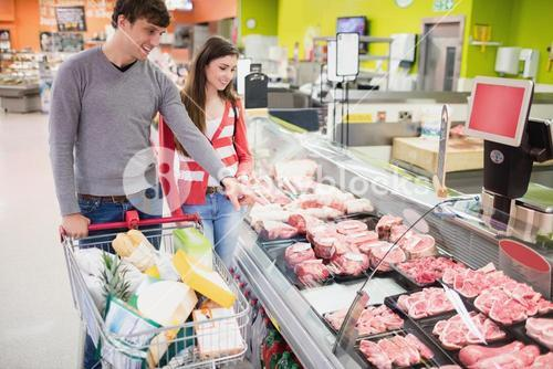 Couple looking at meat counter