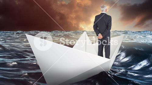 Composite image of rear view of mature businessman posing