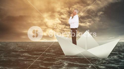 Composite image of thoughtful businessman posing