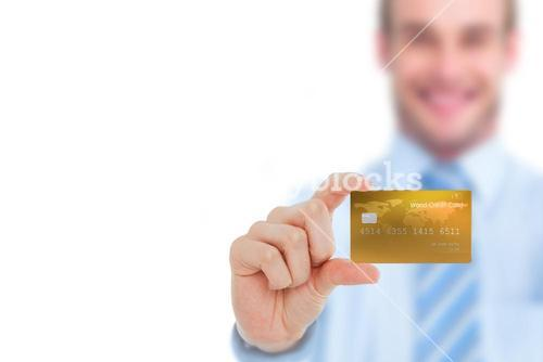 Happy businessman showing a creditcard