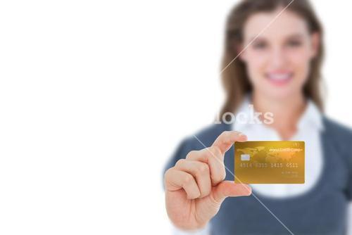 Happy businesswoman showing a creditcard