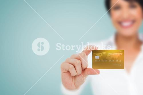 Composite image of happy businesswoman showing a creditcard