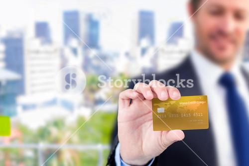 Businessman showing a creditcard