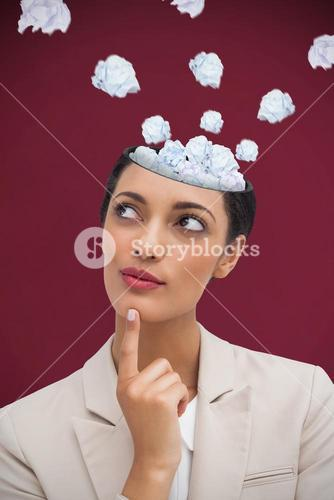 Composite image of smiling businesswoman thinking