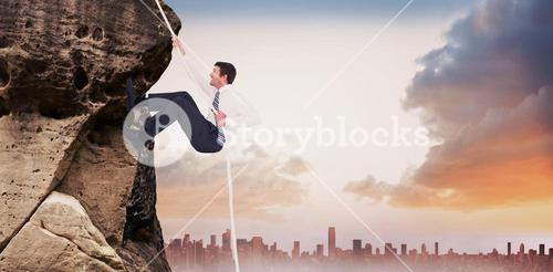 Composite image of businessman pulling a rope