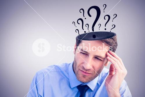 Composite image of stressed businessman holding his head