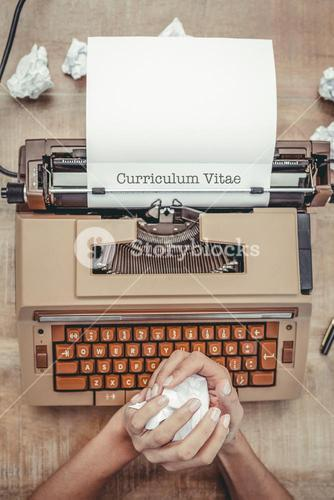 Curriculum vitae against above view of old typewriter