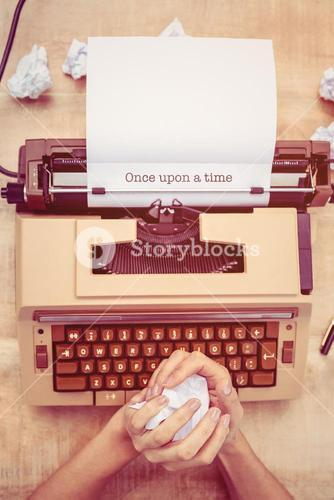 Once upon a time against above view of old typewriter