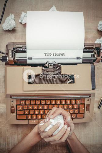 Top secret against above view of old typewriter