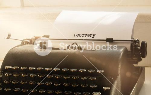Recovery against typewriter on a table
