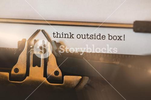Think outside box! against close-up of typewriter
