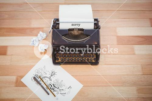 Sorry against typewriter and paper on table in office