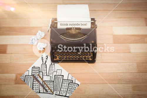 Think outside box! against typewriter and paper on table in office