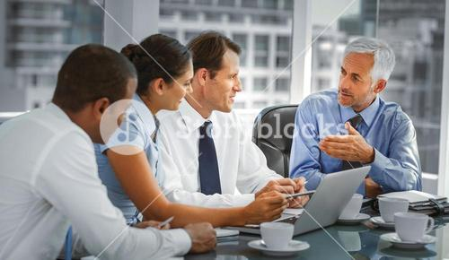 Group of business people brainstorming together