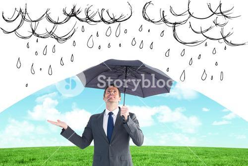Composite image of man protecting from the rain with umbrella