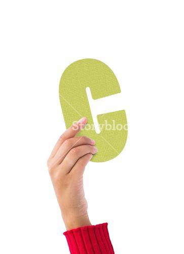 Person holding green C sign