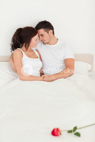 Rose on a bed of delightful couple