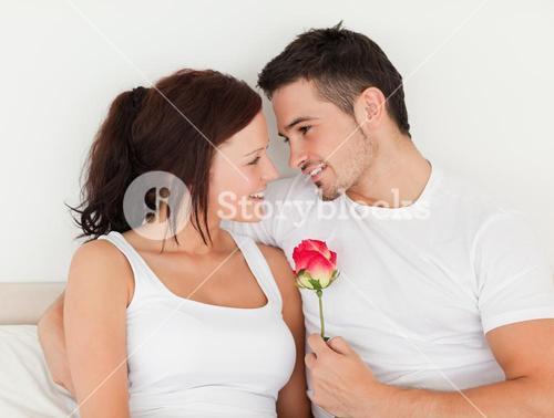 Delightful couple with a rose