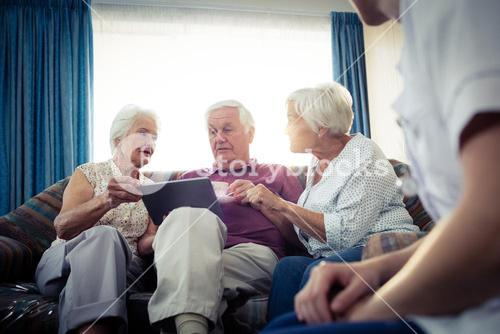 Seniors using a tablet computer