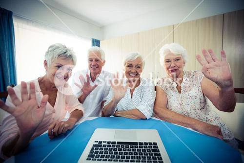 Group of seniors using a computer, view from webcam