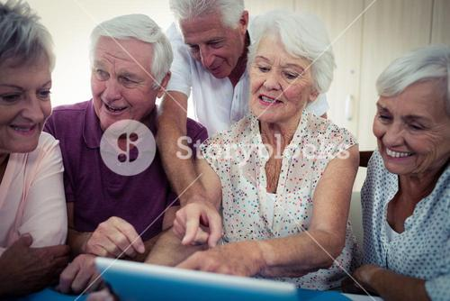 Group of seniors using a computer