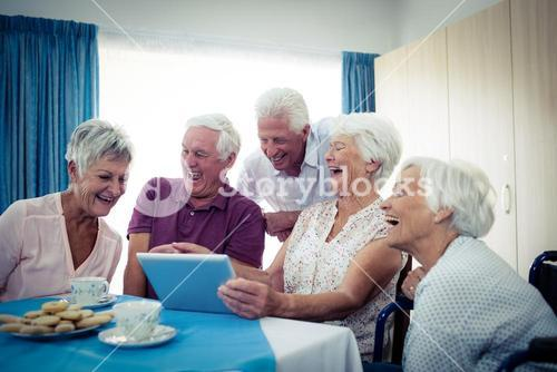Group of seniors using a tablet computer