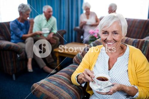 Portrait of a senior woman drinking a coffee