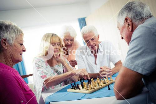 Group of seniors playing chess