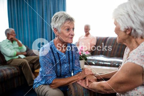 2 senior women interacting