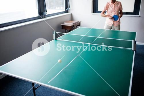 Senior playing ping pong