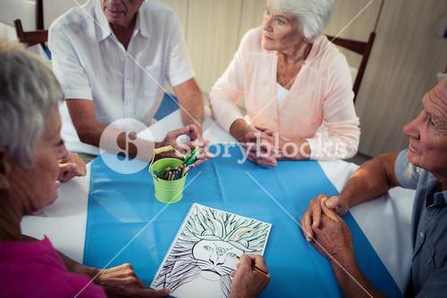 Group of pensioner drawing