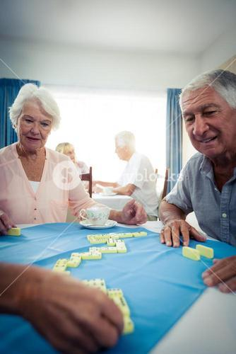 Group of seniors playing dominoes