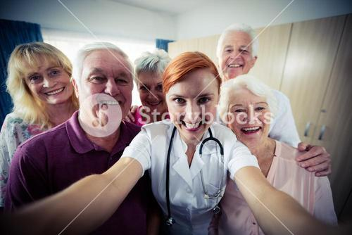 Group of seniors with nurse doing a selfie