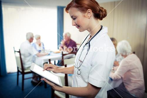 Portrait of a nurse with tablet computer