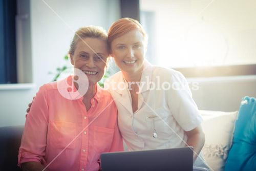 Portrait of female nurse and senior woman