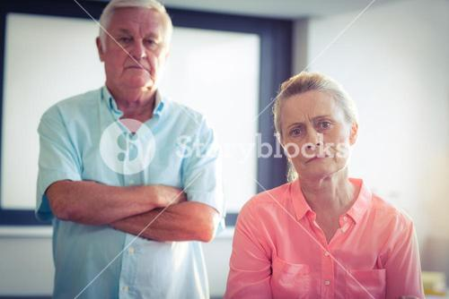 Portrait of unhappy senior couple