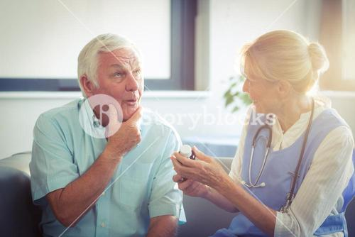 Senior man talking with female doctor
