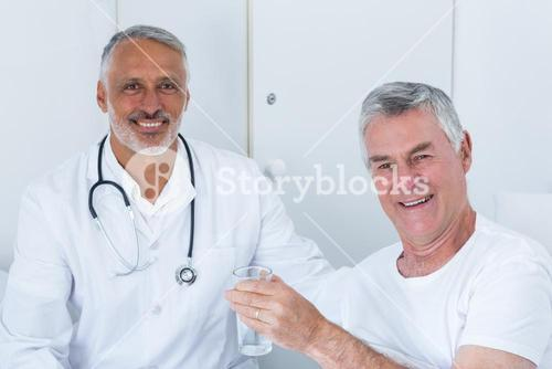 Portrait of happy male doctor and senior man