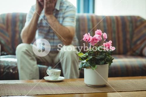 Tea cup and an flower vase on table