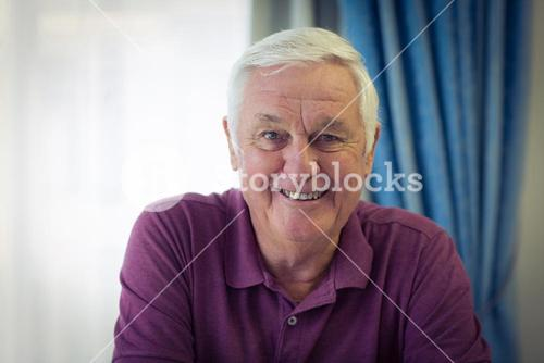 Portrait of senior man sitting in medical clinic