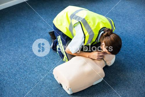 Paramedic during mouth-to-mouth resuscitation training