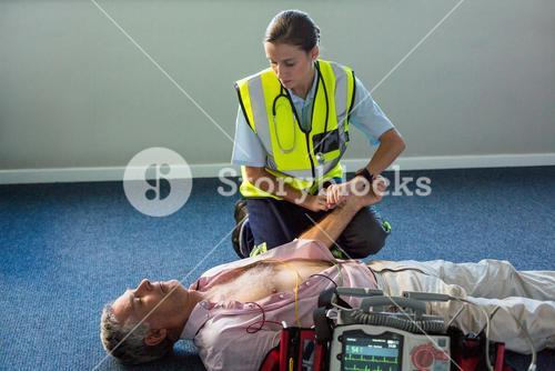 Paramedic examining a patient during cardiopulmonary resuscitation